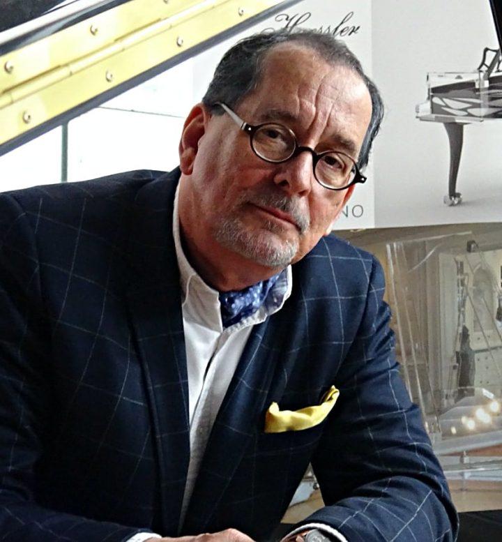 Ken J. Ecury, CEO of Lucid Pianos
