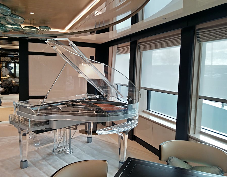 Here is another example of how well suited Lucid pianos are for 'traveling'. This Lucid iDyllic glass acrylic baby grand piano is appointed on a private yacht. The transparency works beautifully for this interior and adds and multiples light into the space.