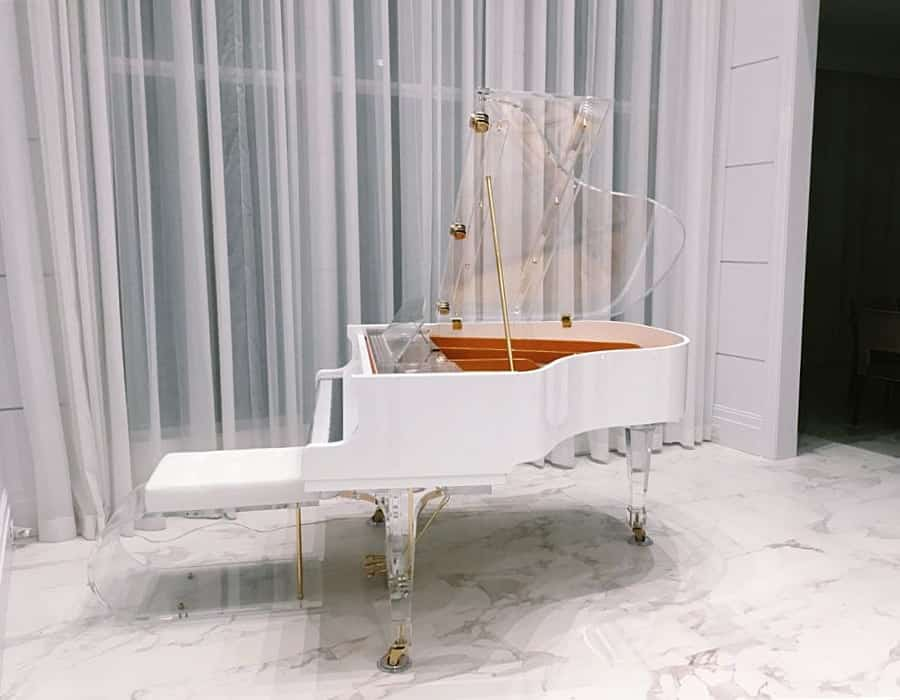 Nothing says Hollywood Regency like this snow white Translucid acrylic baby grand piano with gold hardware.