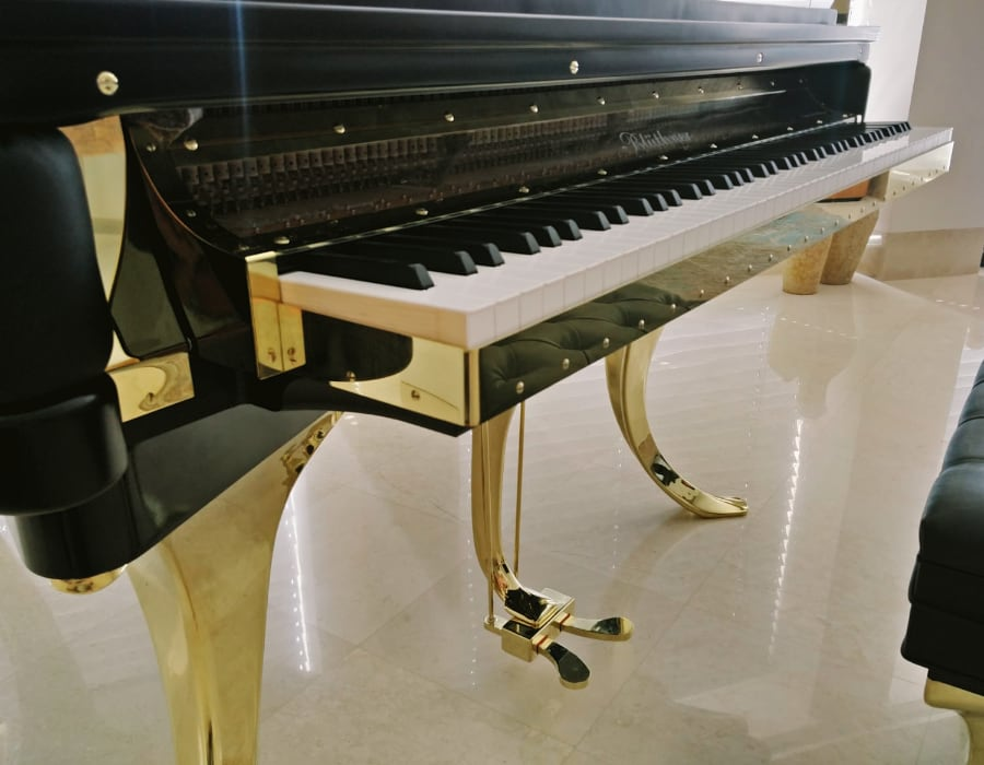 Modern PH piano has a distinguished keyboard that rests on a gold plated bed. The devil is in the details!
