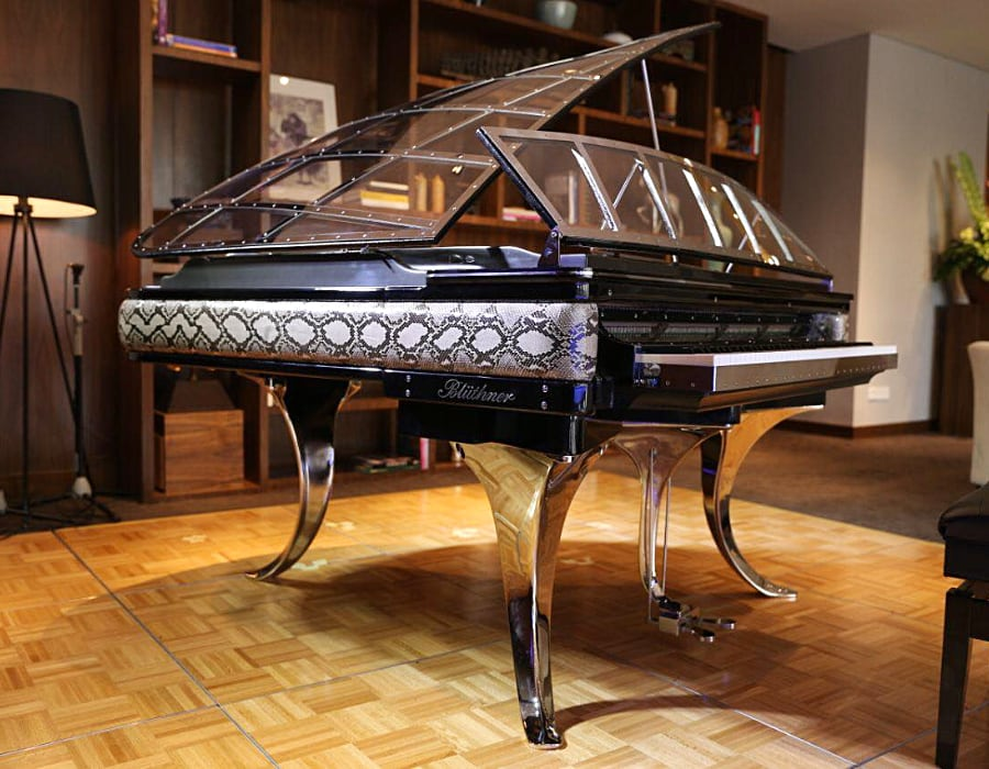 Side panels are made of python leather on this Bluthner PH grand piano. Such a showstopper.