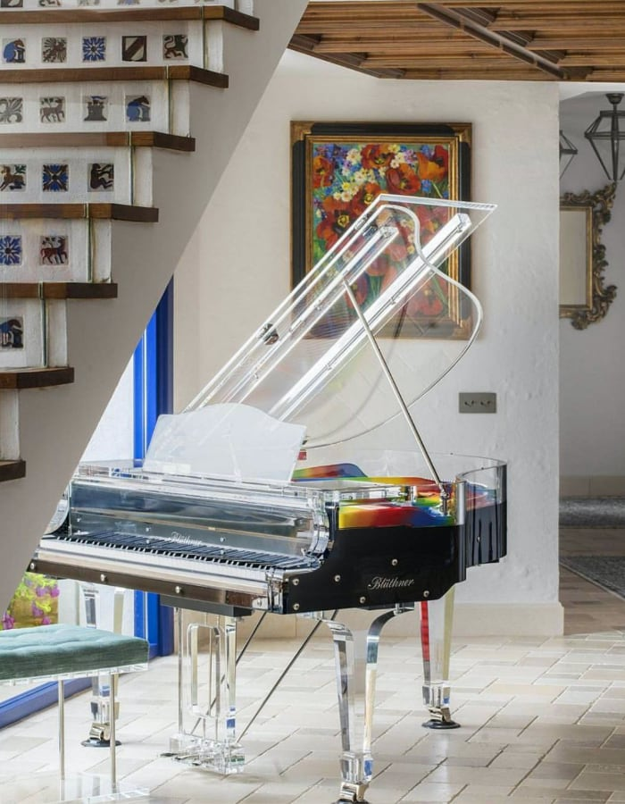 Lucid Elegance acrylic piano - an incredibale balance between tradition and innovation. Here with rainbow plate ideal for Pride entertainment.