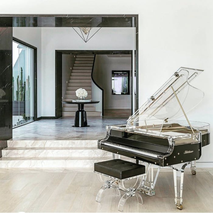 There are hunderds of ways to place the piano. This glass piano looks perfect here.