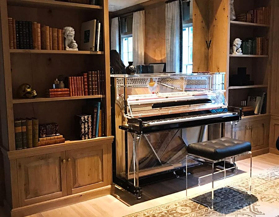 Fully transparent Lucid upright piano in a reading room instantly updates any interior design.