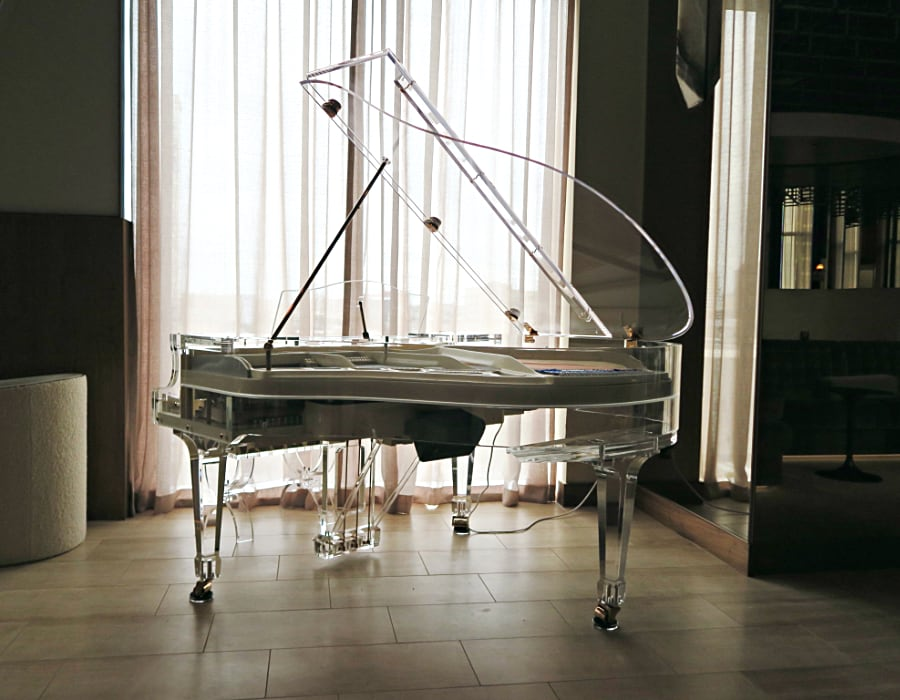 Nothing is more luxe than Lucid iDyllic fully transparent piano beautifully placed in a luxury hotel lobby.