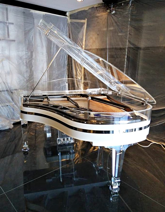 Here is a gorgeous Lucid Elegance glass piano with chrome trim and modern titanium plate.