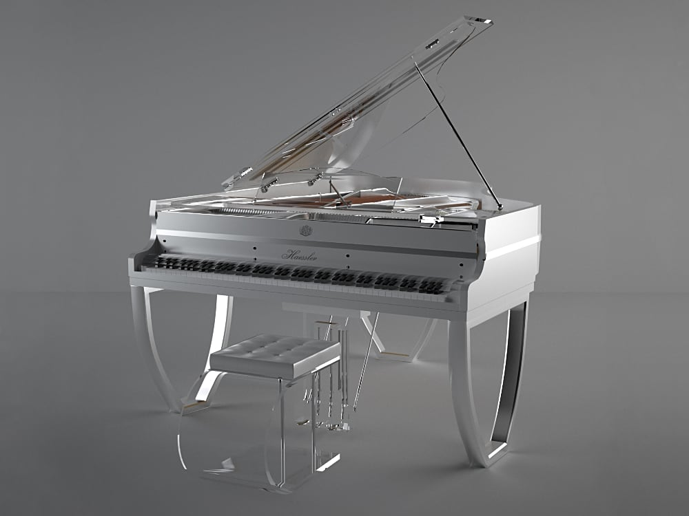 Bluthner TransLucid Tiara is a daring new design from the venerable piano maker. This semitransparent piano features unique V shaped legs that redistribute the weight more evenly across the entire circumference of the piano. This silver color way with chrome metal ribbon make this stunning acrylic piano as delectable as a piece of jewelry. Tiara line is based on the Haessler brand of Bluthner piano family.