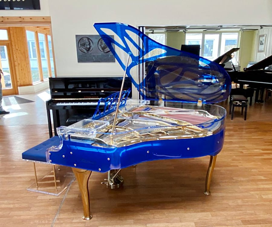 Huve elegance blue baby grand piano with gold trim