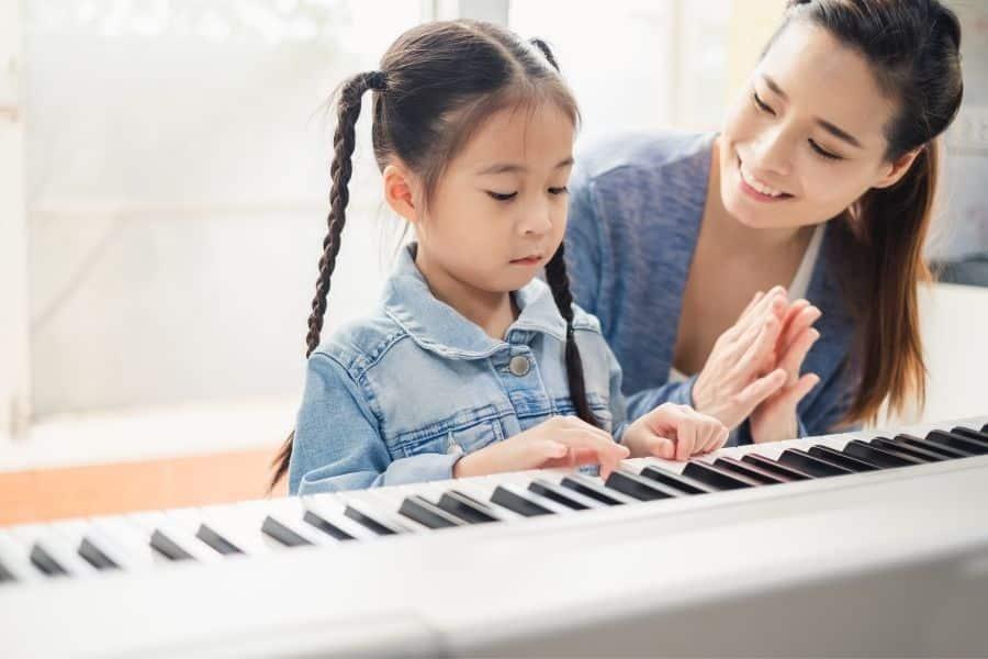piano teacher giving a piano lesson