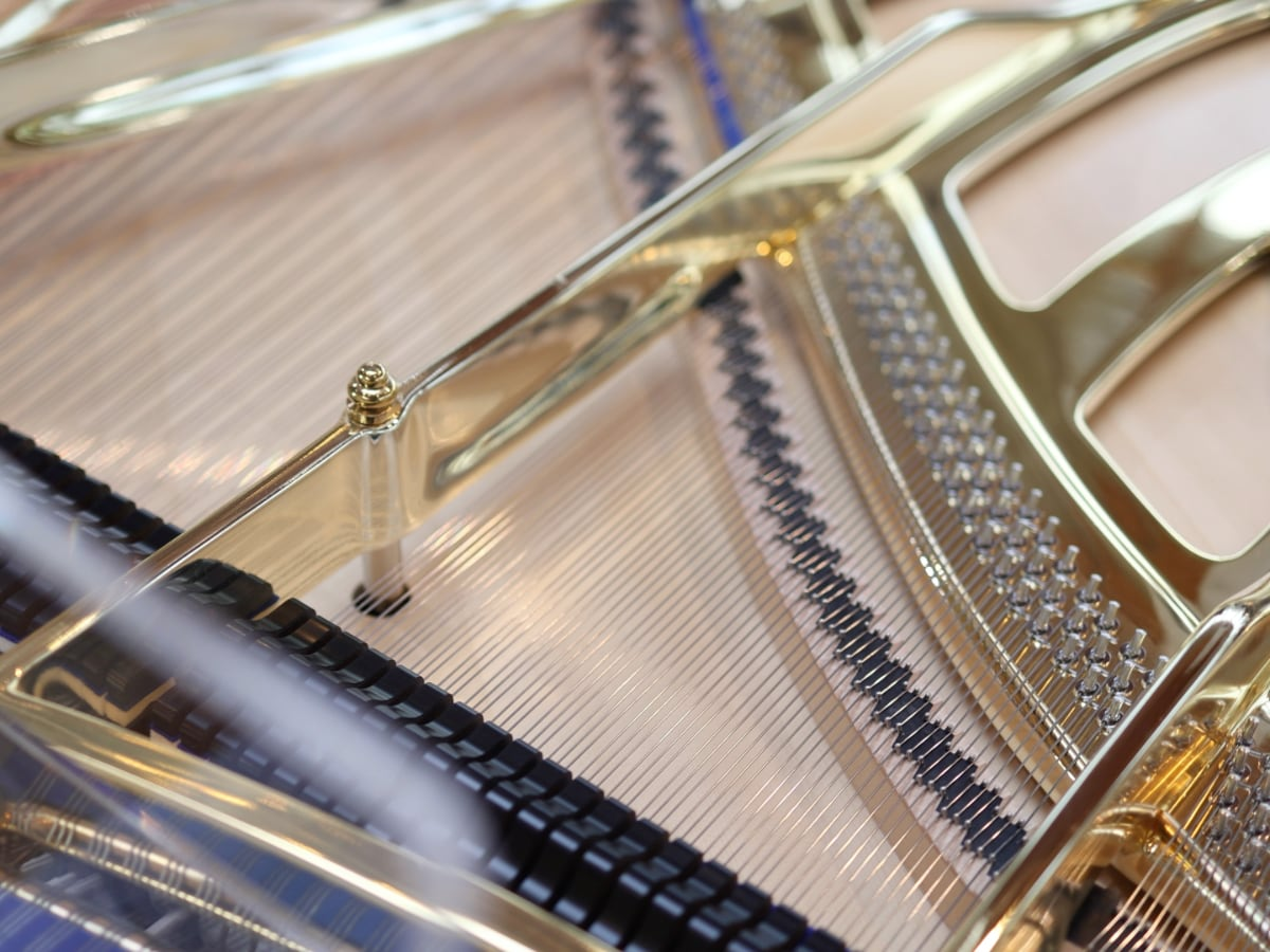 Gold plate on a clear crystal piano